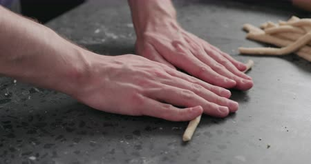 bread stick : Slow motion man making grissini on concretre countertop