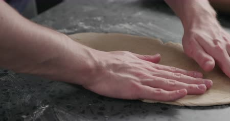 grissini : Slow motion man checking flat dough Stock Footage