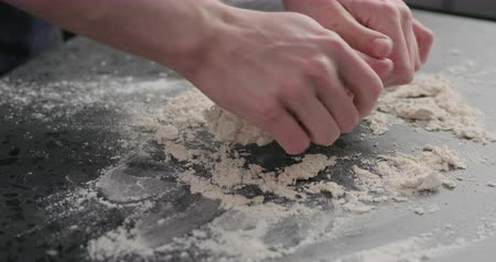 grissini : Slow motion man working with dough on concrete countertop