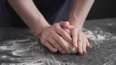grissini : man working with dough on concrete countertop