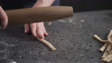 bread stick : man making grissini on concretre countertop