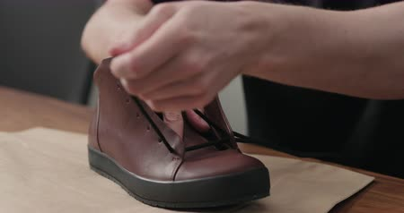 koronka : Slow motion remove laces from sneakers before maintenance Wideo