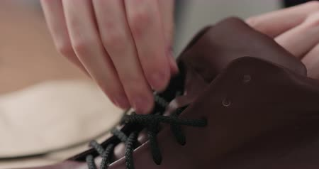 veter : Slow motion remove laces from sneakers before maintenance Stockvideo