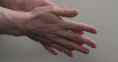 krem : Slow motion man hands applying hand cream closeup Stok Video