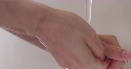 раковина : Slow motion man washing hands under faucet closeup