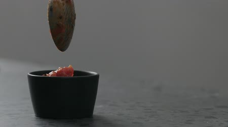 betoniarka : Slow motion put salsa in small black bowl on concrete surface Wideo