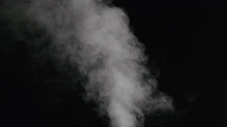mozdony : Slow motion water mist stream with wind effect over black background