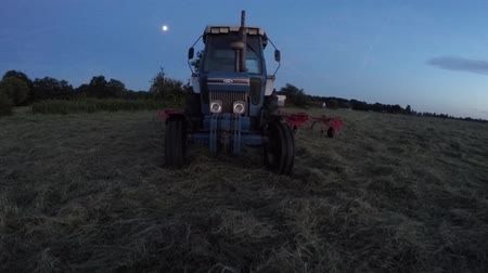 trator : Aerial of tractor at night drop satellite zoom camera very fast filmed by stunt drone 4K