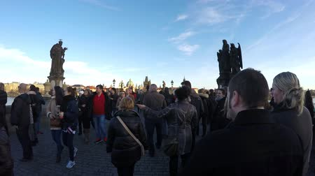 walkthrough : Prague Praha Charles Bridge walk first person view daytime stabilized view time-lapse timelapse speed moving east to west busy with tourists on bridge one of most visited tourist attractions 4k Stock Footage