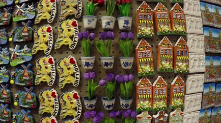 solder : Dutch refrigerator magnets in a tourist shop in Holland the Netherlands very colorful display with small Dom Towers tulips canalhouses wooden shoes made magnets for tourism popular as presents 4k