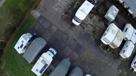 rv park : Aerial top down view flying over parked travel trailers, camper trailers and caravans recreational vehicles being stored in winter and picked up in the spring for holiday vacation Purposes used for camping 4k Stock Footage