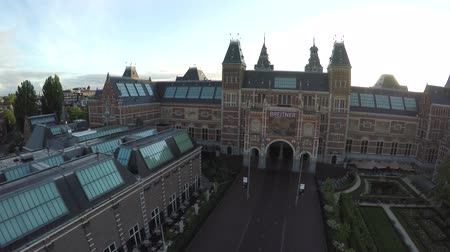еще : Aerial Amsterdam at sunrise showing Rijksmuseum drone slowly moving up Dutch national museum dedicated to arts and history Amsterdam popular tourist attraction in Holland very early no people yet 4k