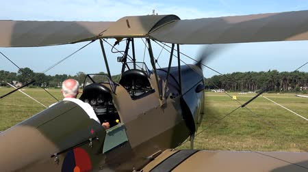 wwi : Old world war one airplane biplane starting engine then driving off fixed-wing aircraft with two main wings stacked one above the other place for two people to pilot plane very good condition 4k