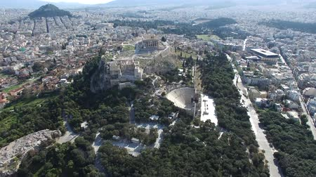 dionysus : Aerial UAV above Greece Athens arriving at the Acropolis of Athens ancient citadel located on rocky outcrop showing Parthenon very famous tourist attraction in Europe Greece European visit 4k quality Stock Footage