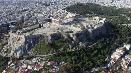 dionysus : Aerial flying around the Acropolis of Athens ancient citadel located on rocky outcrop showing Parthenon very famous tourist attraction in Europe Greece European visit Further more showing downtown 4k