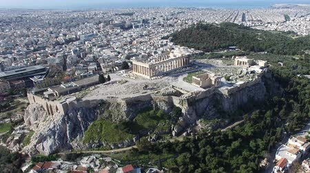 dionysus : Aerial drone bird-eye view moving around front of the Acropolis of Athens ancient citadel located on rocky outcrop showing Parthenon very famous tourist attraction in Europe Greece European visit 4k