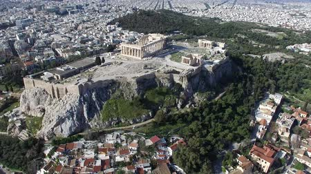 dionysus : Aerial drone top down view looking down onto front of Acropolis of Athens ancient citadel located on rocky outcrop showing Parthenon very famous tourist attraction in downtown Athens Europe Greece 4k