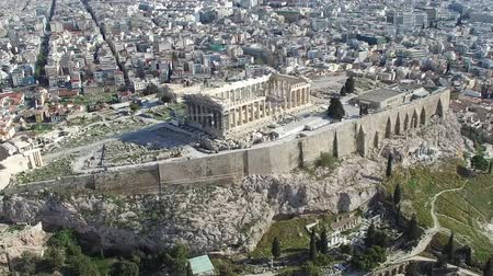 dionysus : Aerial drone birdview close up flight around the Acropolis of Athens ancient citadel located on rocky outcrop showing Parthenon very famous tourist attraction in Europe Greece nice European city 4k Stock Footage