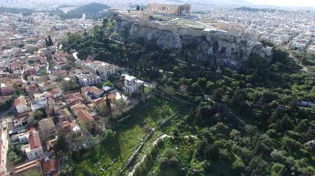 dionysus : Aerial drone bird-eye view moving up for flight around the Acropolis of Athens ancient citadel located on rocky outcrop showing Parthenon very famous tourist attraction in Europe Greece great city 4k
