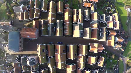 charakteristický : Aerial of Marken top down view looking down on typical Dutch village it forms a peninsula in the Markermeer and was formerly an island in the Zuiderzee characteristic wooden houses are a tourist attraction 4k