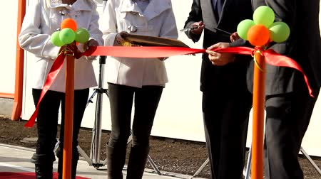 fitas : New opening. Cutting the ribbon with a scissors