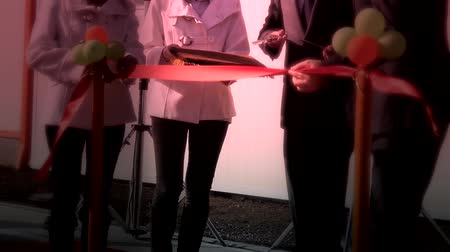 unveil : New opening. Cutting the ribbon with a scissors