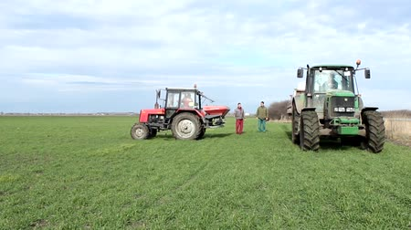 trator : tractor get ready for topdressing wheat in the field with minerals