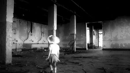 abandoned cute  little girl in ruined house