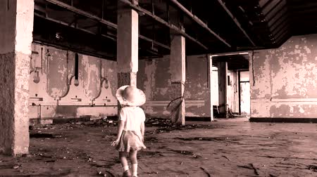 abandonment : abandoned cute  little girl in ruined building Stock Footage
