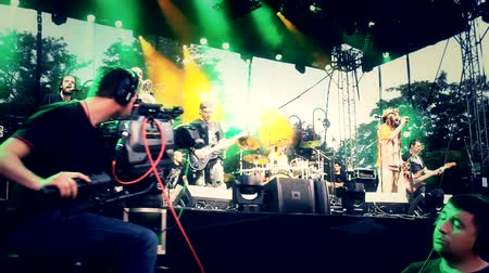 loud music : Camearaman Dolly Track,cameras and media photographers on music festival