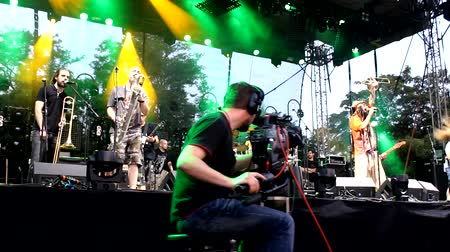 ska : Cameraman on Dolly Track,cameras and media photographers on music festival
