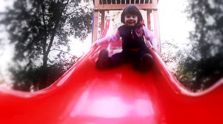 sport dzieci : small girl goes down on the  slide toboggan 1920x1080 full hd footage Wideo