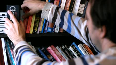 schoolbook : browsing book collection Stock Footage