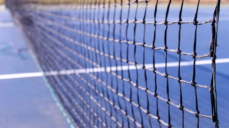 tennis game : tennis net and hard blue court