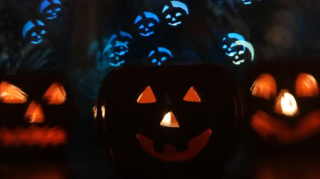 snow sparkle : Halloween pumpkins bokeh lights Stock Footage