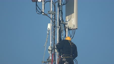 Worker working on the installation antennas
