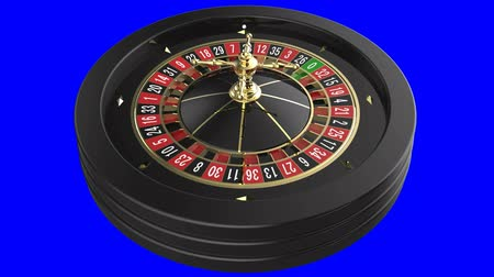 Casino Roulette Wheel isolated on blue background Stock mozgókép
