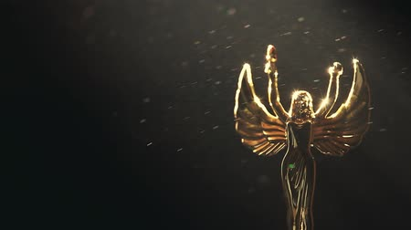 heykelcik : Gold Woman Statue dark background Stok Video