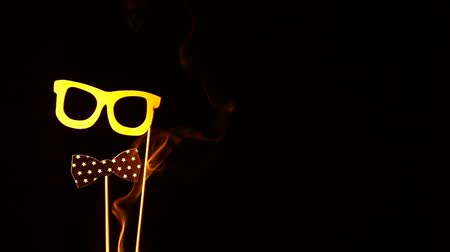 to disguise : yellow mask smoke dark background nobody hd footage Stock Footage