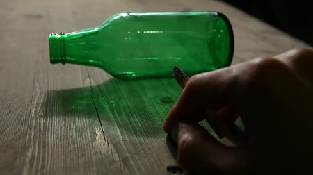 rehabilitasyon : empty bottle hand cigarette wooden table hd footage nobody