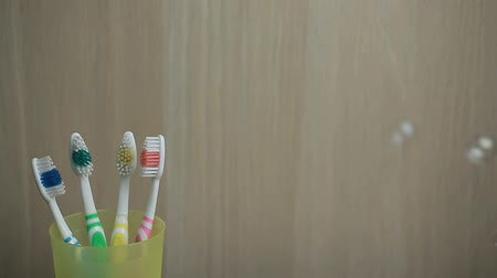 higiênico : toothbrush soap bubbles wooden background nobody hd footage Stock Footage