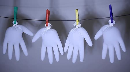wasknijper : clothespin white latex gloves white background nobody hd footage