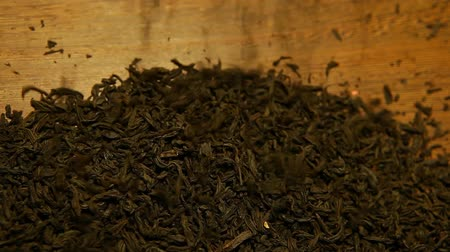 leafs : black tea wooden background nobody hd footage