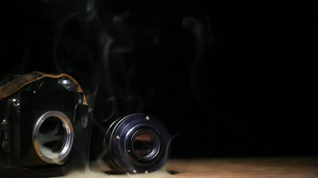sinematografi : camera smoke dark background hd footage