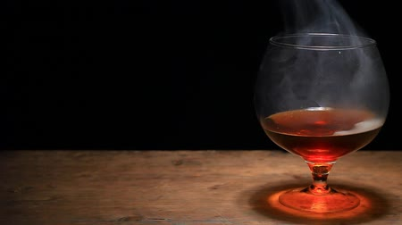 excluir : whiskey glass smoke dark background nobody hd footage studio Stock Footage