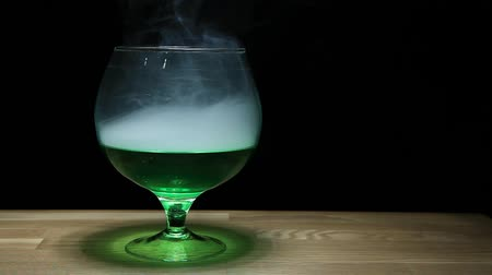 alchemy : Absinthe glass smoke wooden table hd footage nobody
