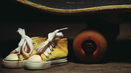 skateboard deck : yellow sneakers skateboard wooden desk nobody