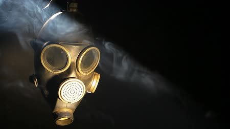 biological danger : Gas mask and smoke on dark background  hd footage