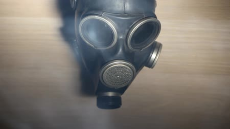 biological danger : anti gas mask on  wooden background  hd footage Stock Footage