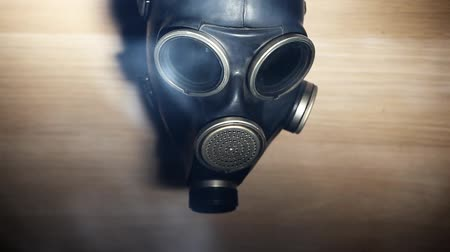 hajtogatott : anti gas mask on  wooden background  hd footage Stock mozgókép